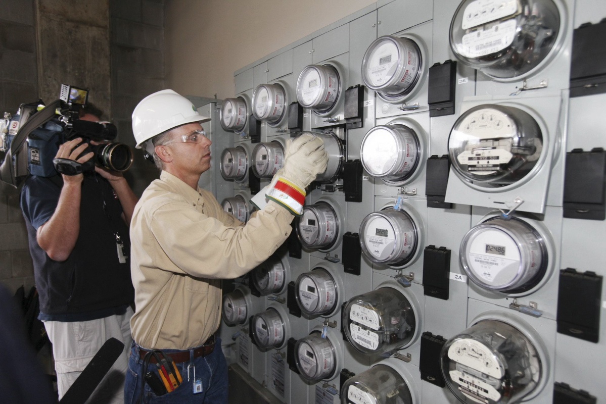 A Central Maine Power technician works in Portland in 2010. The power company is the focus of a billing probe.
