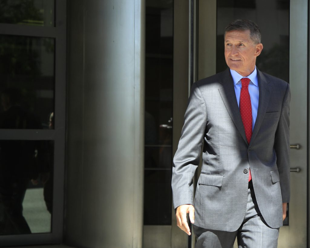 Former Trump national security adviser Michael Flynn leaves a federal courthouse in Washington on Tuesday following a status hearing.