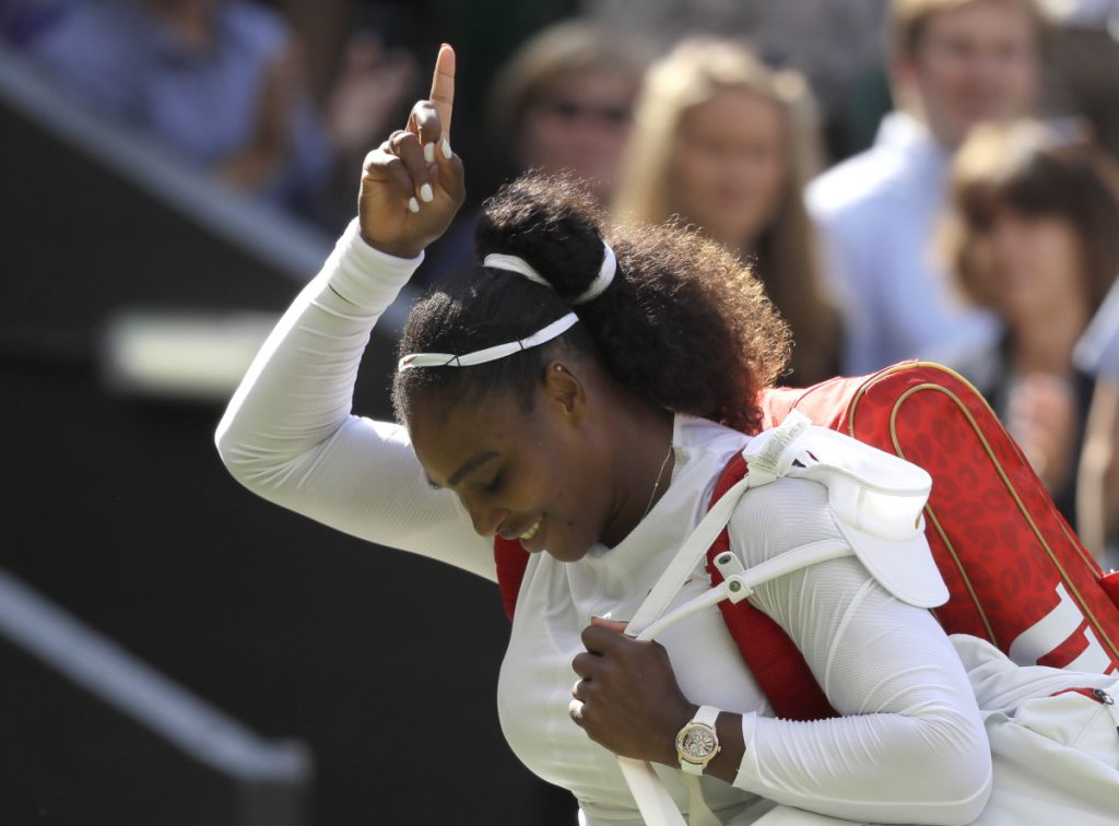 Serena Williams celebrates her quarterfinal victory against Italy's Camila Giorgi on Tuesday at the Wimbledon tennis championships in London.