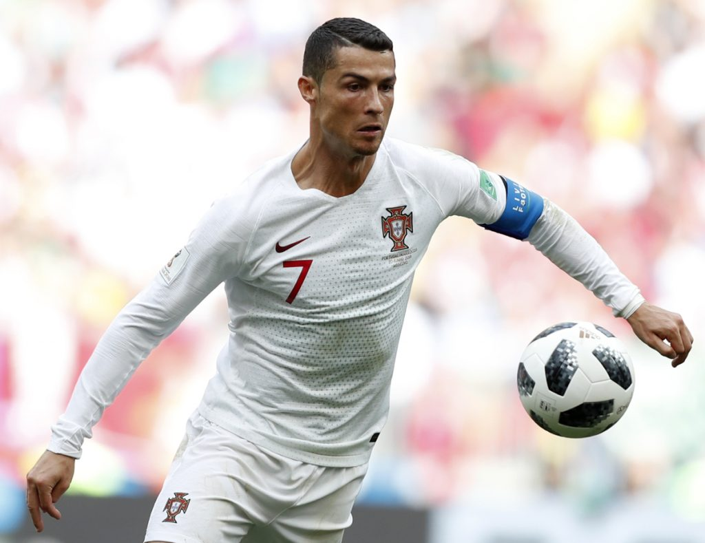 Portugal's Cristiano Ronaldo goes for the ball during a Group B match between Portugal and Morocco at the 2018 soccer World Cup in Moscow on June 20. (AP Photo/Francisco Seco)