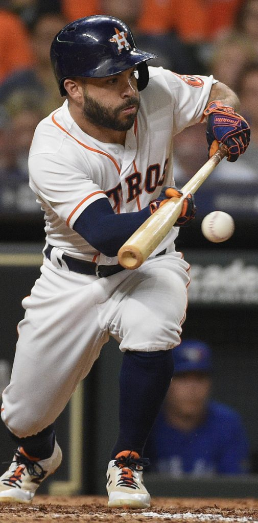 Jose Altuve of the Astros lays down a sacrifice bunt during a game against Toronto on June 26. Teams sacrifice less than half as often as 25 years ago.