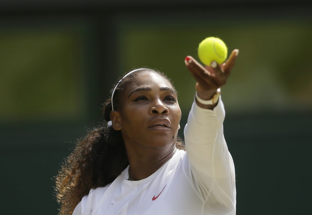 Serena Williams serves to Germany's Julia Gorges during their semifinal match at the Wimbledon Tennis Championships in London on Thursday. Williams advanced to Saturday's final with a 6-2, 6-4 victory. (AP Photo/Tim Ireland)