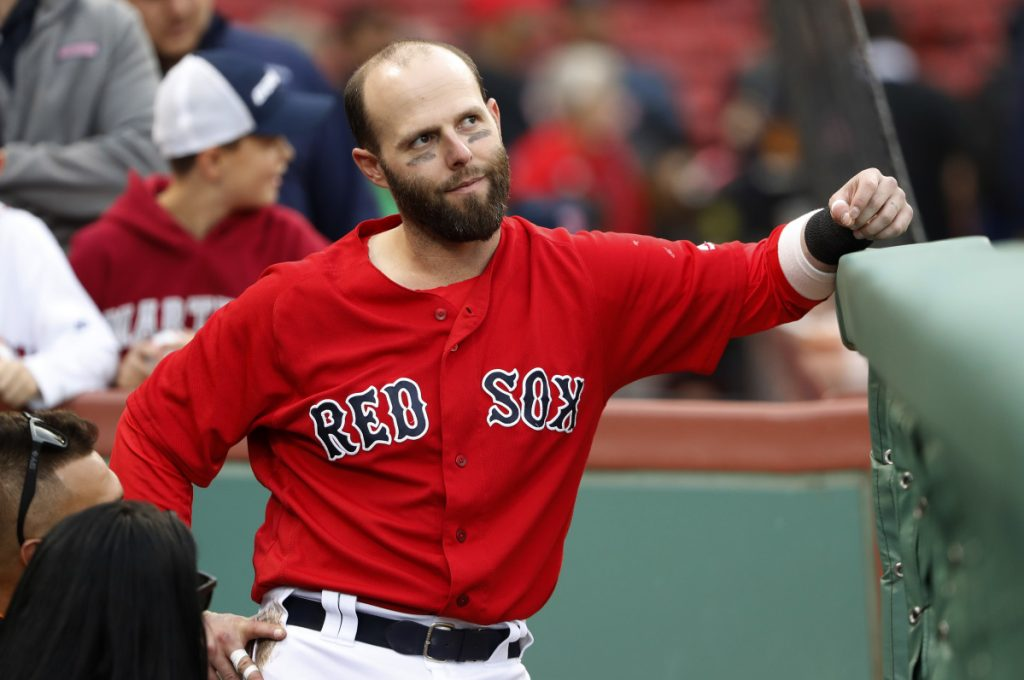 Boston Red Sox second baseman Dustin Pedroia looks on from the dugout before a game last September at Fenway Park in Boston. (AP Photo/Winslow Townson)