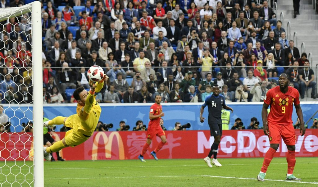 France goalkeeper Hugo Lloris, deflecting a shot by Belgium in the semifinals, wants his team to go one step further than the 2016 European Championships, when it lost in the final.