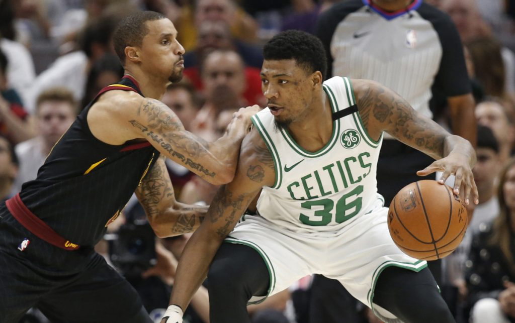 Marcus Smart, right, is definitely the type of gritty player that the Boston Celtics like, but they don't want to give a multiyear deal when a matching offer would keep him this season.