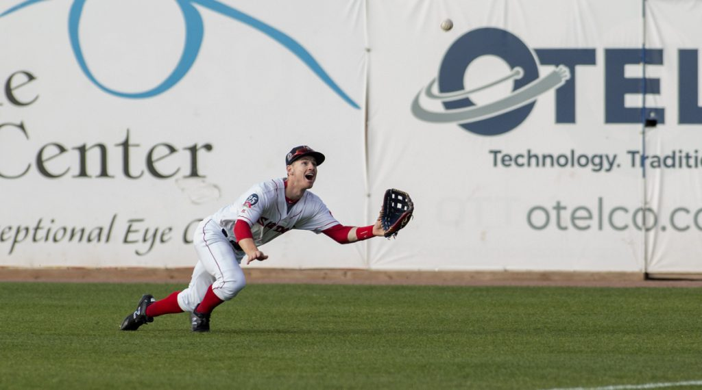 Right fielder Danny Mars of the Sea Dogs dives to haul in the ball at Hadlock Field. Portland defeated New Hampshire, 5-4.