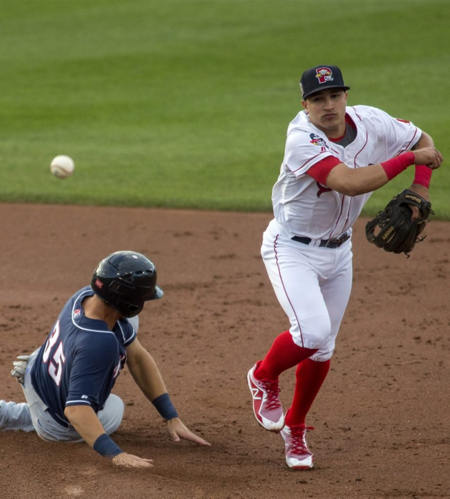 Jeremy Rivera of the Portland Sea Dogs throws to first to complete a double play Thursday night after forcing Nash Knight of the New Hampshire Fisher Cats at second.