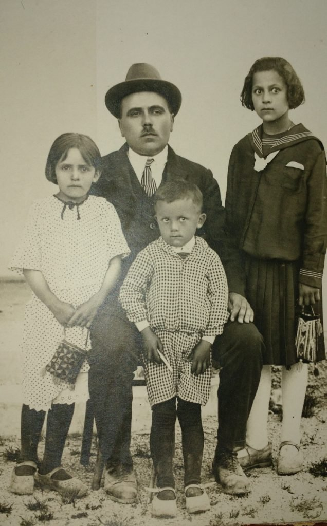 A father and three children pose in the early 1920s. They could not know what history had in store.