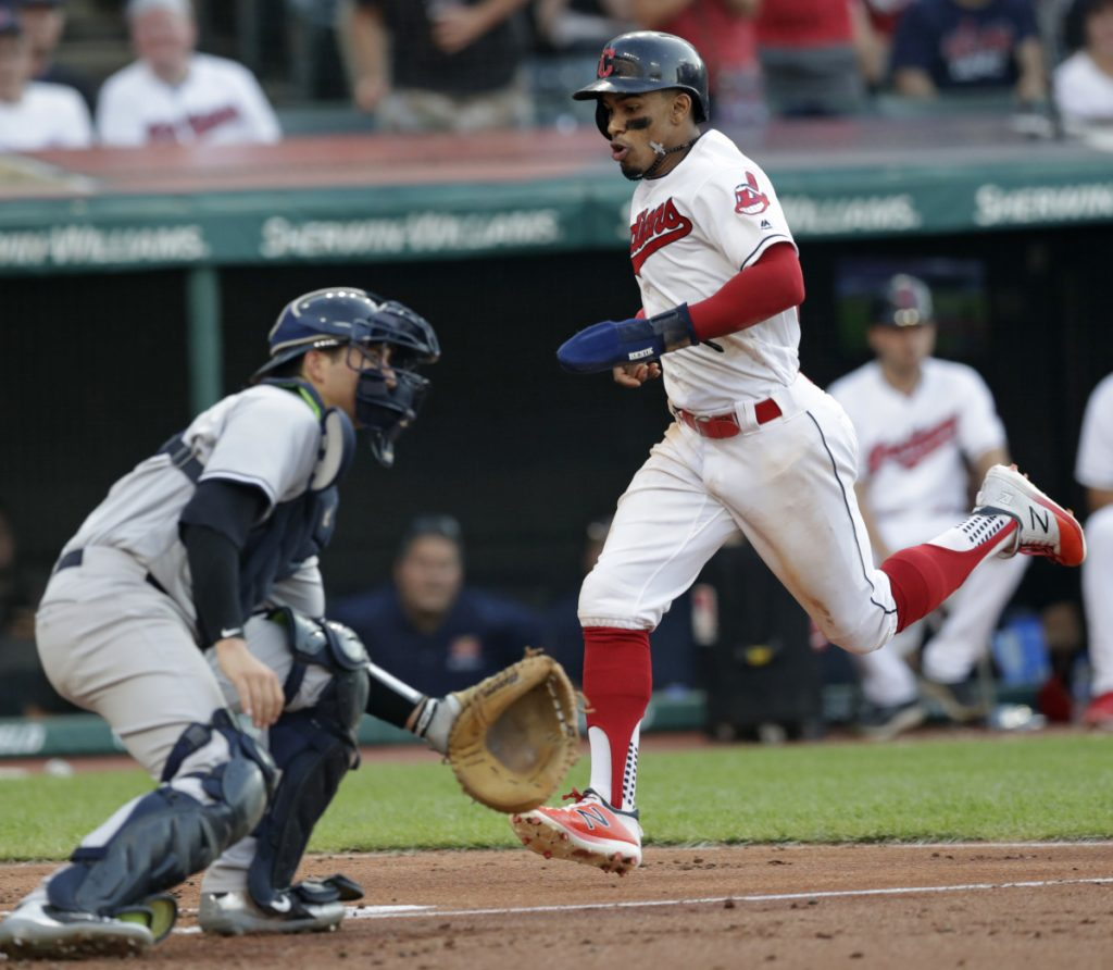 Francisco Lindor scores a run for the Indians as Yankees catcher Kyle Higashioka waits for the late throw Friday night. Cleveland ended a seven-game losing streak against New York dating back to last year's playoffs, holding on for a 6-5 win.