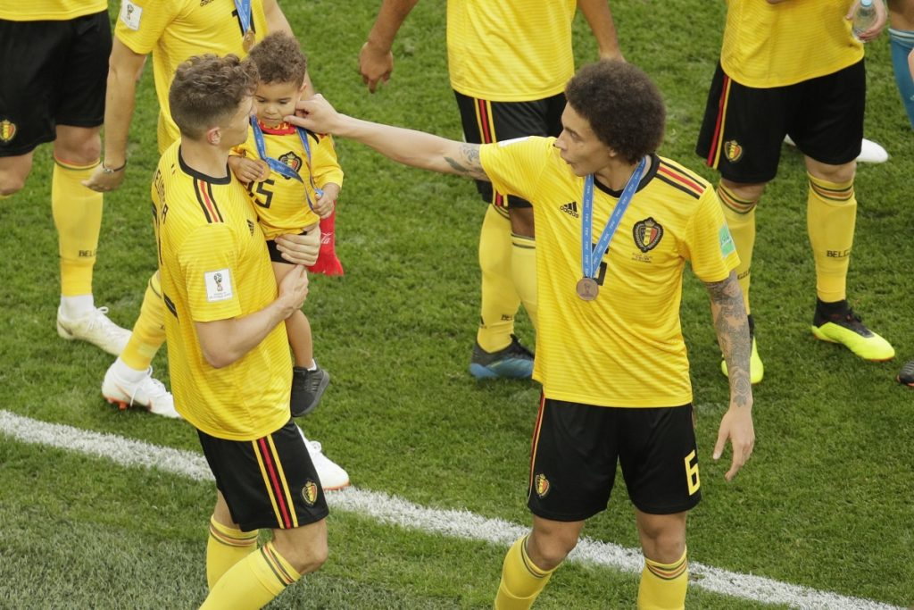 Belgium's Axel Witsel, right, and his teammates leave the pitch after winning their third place match against England at the 2018 World Cup in the St. Petersburg Stadium in Russia on Saturday. Belgium defeats England 2-0.