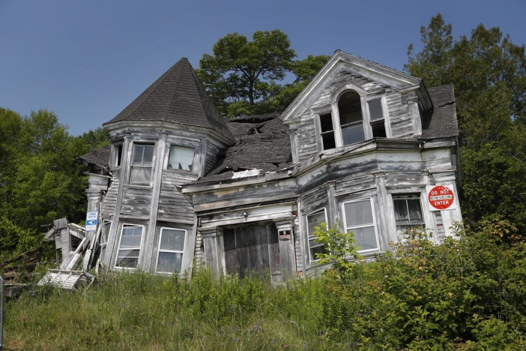 This condemned former home of a sea captain on Route 1 in Searsport is being dismantled, says its owner, just very slowly. The town asked Doug Brown two years ago to tear it down. The house was built in the 1860s by Capt. Joseph Loomis Park.