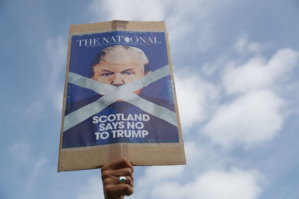 A demonstrator makes his feelings known as people gather to protest a visit by President Trump to Turnberry, Scotland, on Saturday.