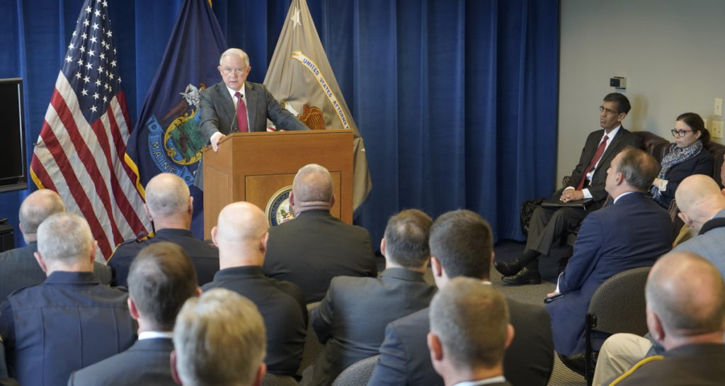 U.S. Attorney General Jeff Sessions speaks to local law enforcement officers in Portland on Friday on his approach to the opioid epidemic. On the same day, a local treatment center closed for lack of federal funding.