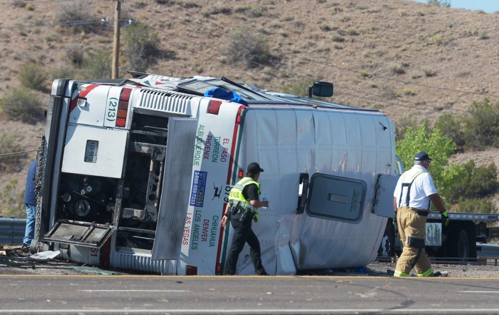 Emergency personnel work at the scene of a deadly crash involving a bus that occurred on Interstate 25 just north of Bernalillo, N.M., early Sunday. Three people died in the accident that also involved three other vehicles.
