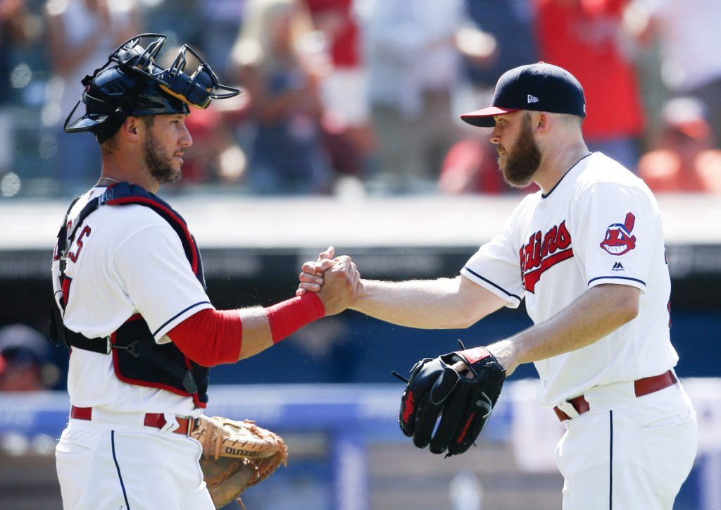 Cleveland catcher Yan Gomes, left, and closer Cody Allen celebrate Sunday after the 5-2 win over the New York Yankees. The teams split a four-game series.