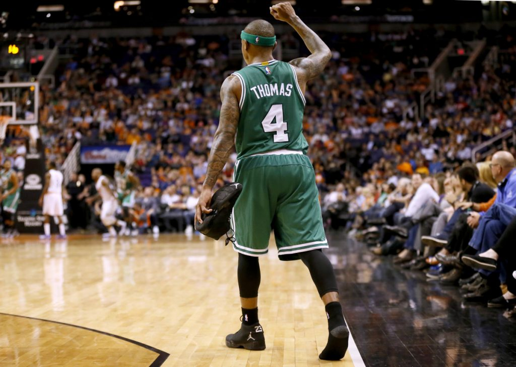 Phoenix Suns Boston Celtics' Isaiah Thomas (4) pumps his fist after losing his shoe during the second half of an NBA basketball game against the Phoenix Suns Monday, Feb. 23, 2015, in Phoenix. The Celtics won 115-110. (AP Photo/Matt York)