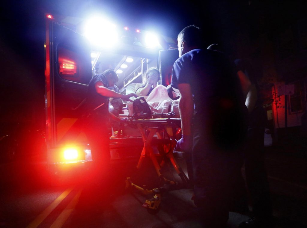 Portland paramedics respond to a call of a heroin overdose on Congress Street near the intersection of India Street. The 29-year-old woman was found unconscious by a passer-by after she had injected herself with a quarter-gram of heroin.