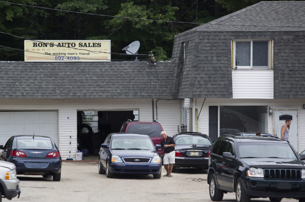 An informant and witnesses told authorities that sheets of counterfeit money were being printed in the downstairs office of Ron's Auto Sales, a used car dealership in Windham.