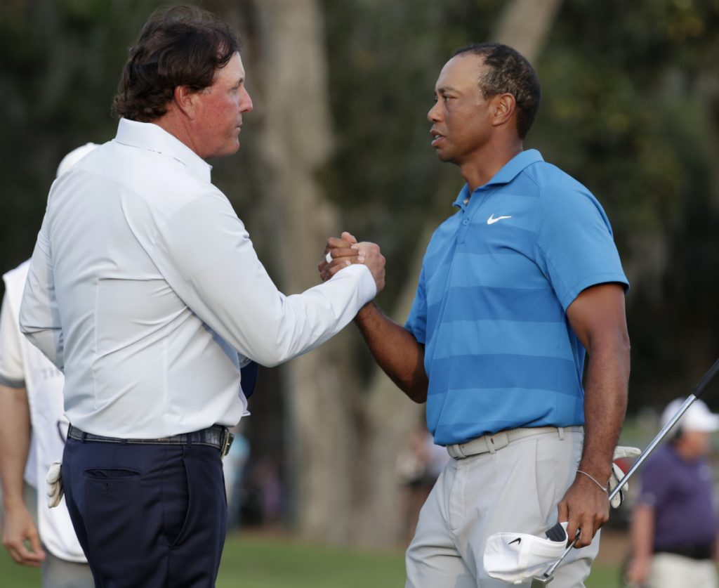 Phil Mickelson, left, and Tiger Woods, who have combined to win one golf tournament since the end of 2013, may be looking to remain relevant with a television showdown.