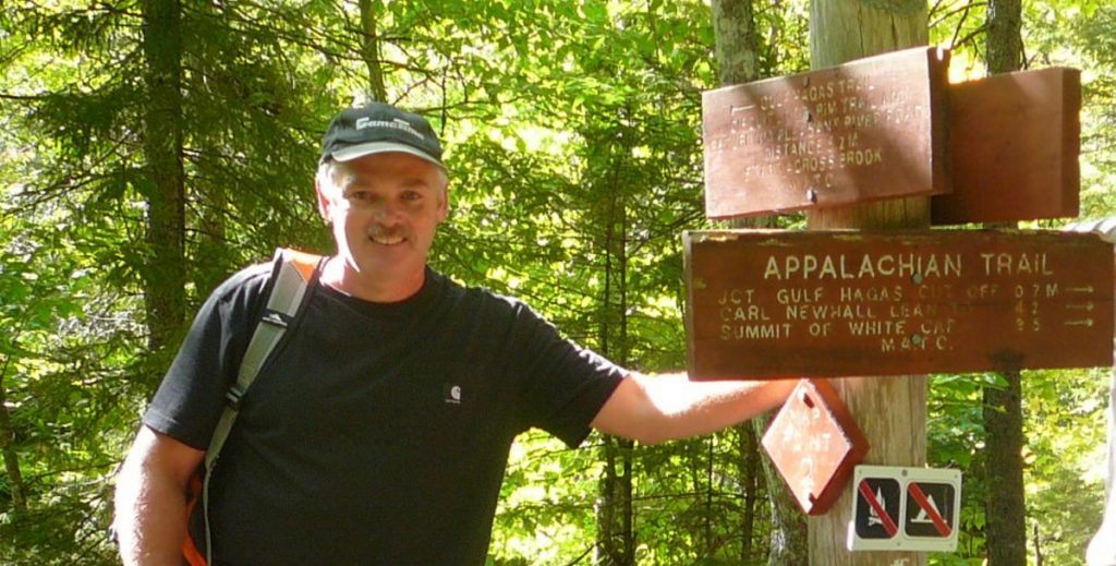 Director of the University of Maine at Farmington Fitness and Recreation Center Jim Toner stands at a crossroads recently along the Appalachian Trail. Toner, of New Vineyard, died Monday, almost one year after he was diagnosed with gall bladder or bile duct cancer.