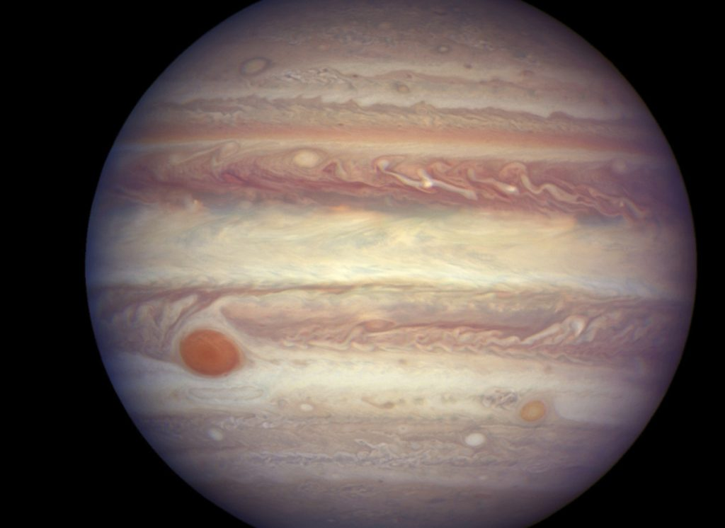 One of Jupiter's 12 new moons is being labeled an 'oddball' as it's circling in the same direction as the planet, opposite from the other 11.