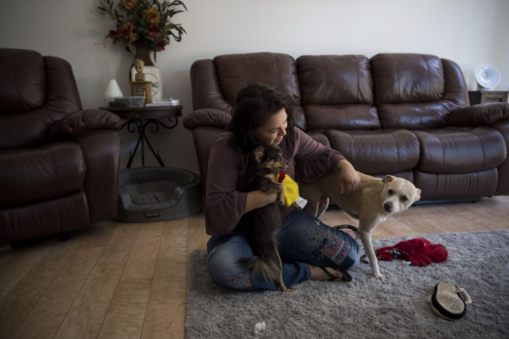 Ruby Torres plays with her dogs Angel and Dora. She was given custody of Angel during her divorce, but not her embryos.