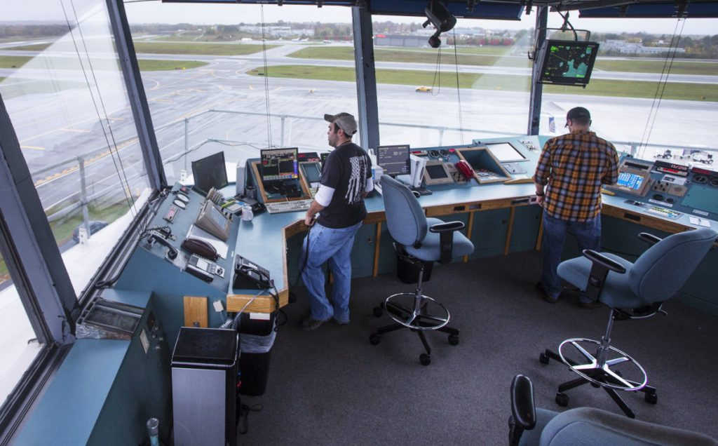 The 25 air traffic controllers in Portland who are members of the National Air Traffic Controllers Organization will continue to work despite the lack of pay. Controllers are shown at work in July.