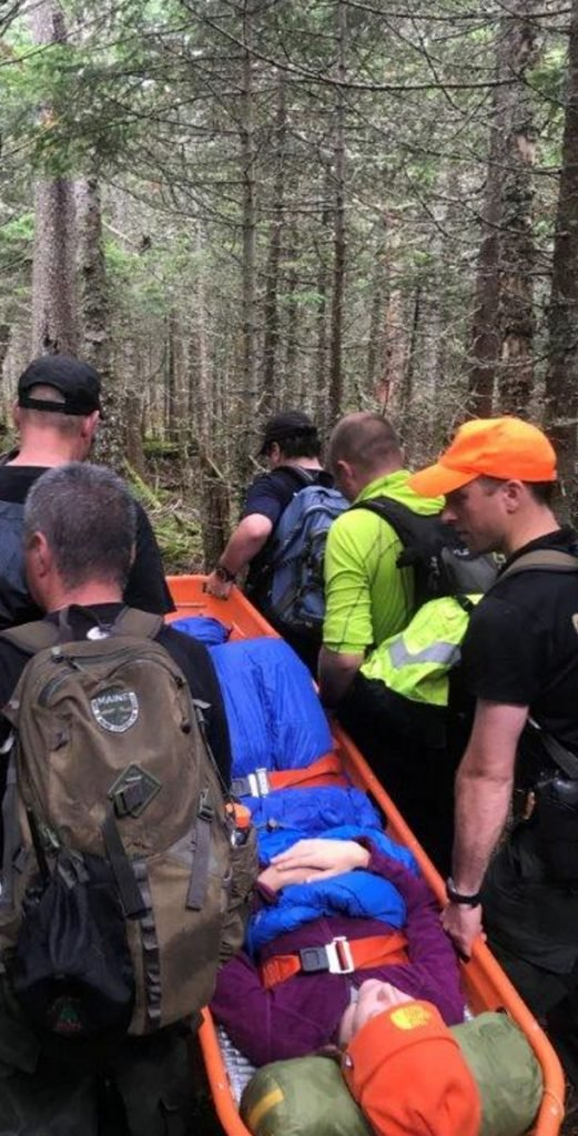 A team of emergency responders rescue Andrea Pincumbe, 21, of Asheville, N.C., from the Poplar Ridge lean-to atop Saddleback Mountain on Tuesday.