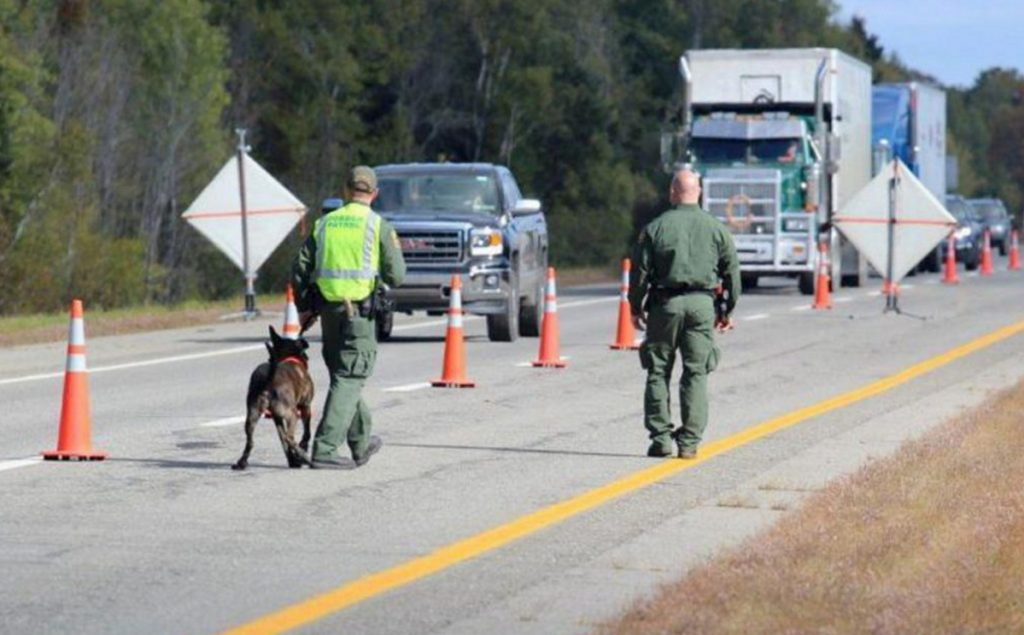 U.S. Border Patrol agents operate a citizenship checkpoint in June along Interstate 95 between the Penobscot County towns of Howland and Lincoln.