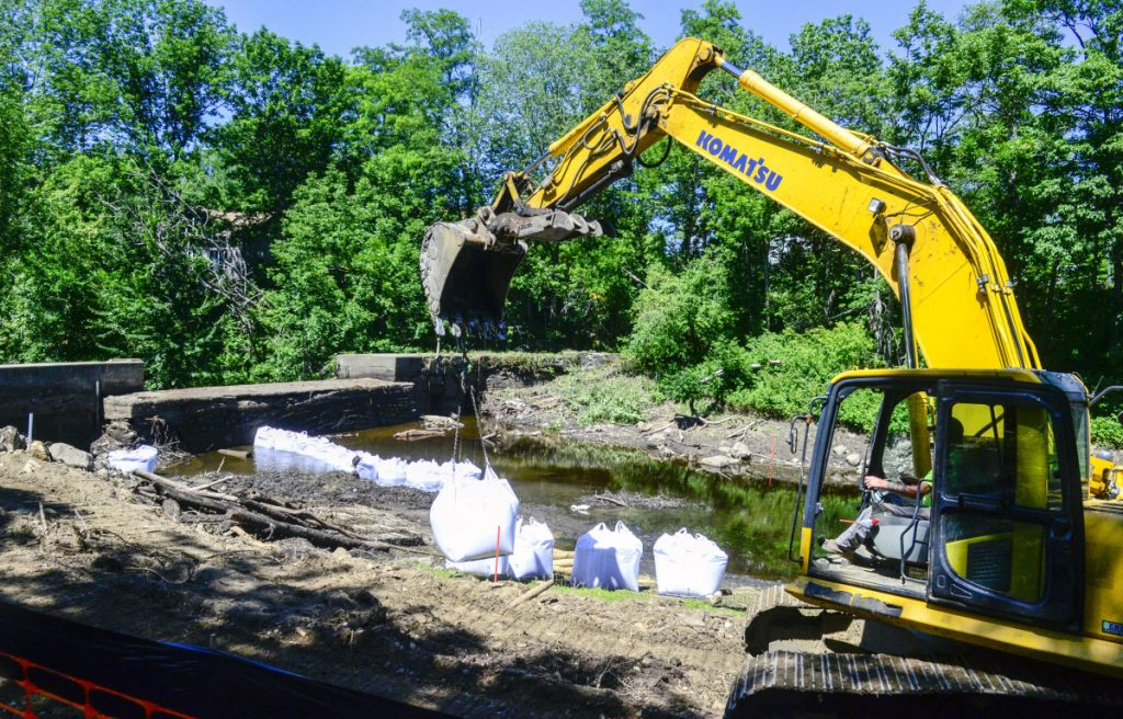 Crews begin demolition Thursday on the Coopers Mills dam on the Sheepscot River in Whitefield.