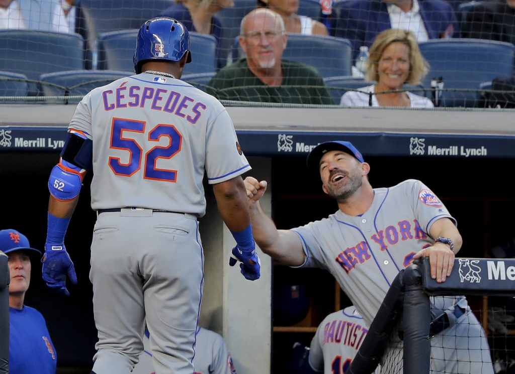 Yoenis Cespedes of the Mets is congratulated by Manager Mickey Callaway after hitting a home run against the Yankees Friday night in New York.