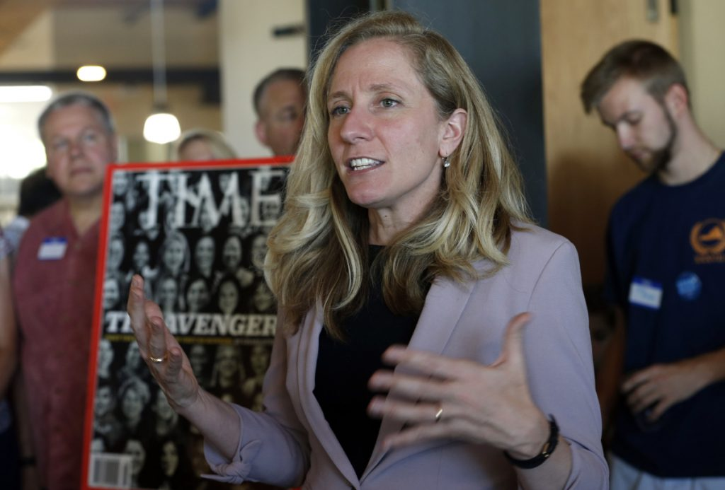 Former CIA officer and Democratic candidate for the 7th district Congressional seat, Abigail Spanberger, center, speaks to supporters at a rally in Richmond, Va., on Wednesday.  Opposition to President Donald Trump is changing the political map for Democrats who find themselves riding a wave of anti-Trump energy to compete in areas they once left for lost.