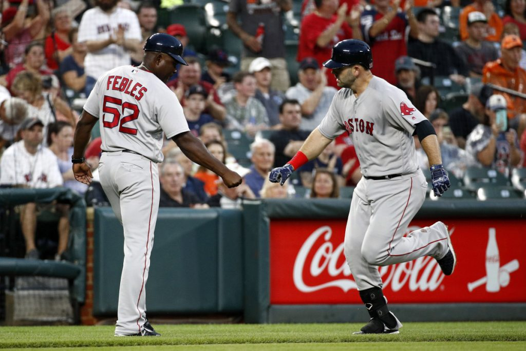 Boston's Mitch Moreland, right, rounds the bases past third base coach Carlos Febles after hitting a solo home run in the second inning of the Red Sox' 5-3 win Monday night in Baltimore.