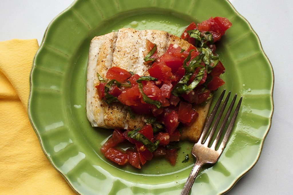 Pick your favorite mild white fish and top it with a tomato basil mixture, similar to what you'd put on top for bruschetta.