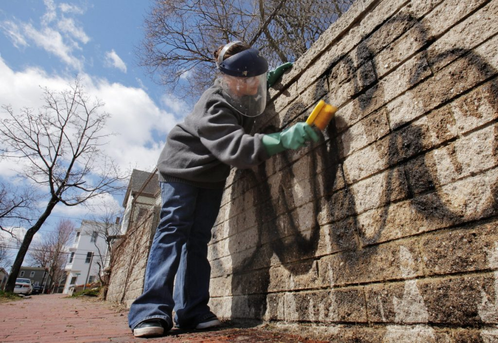 Graffiti is removed from a wall along Moody Street in 2011. Since 2015, more than 700 graffiti markings have been removed after complaints to the city.