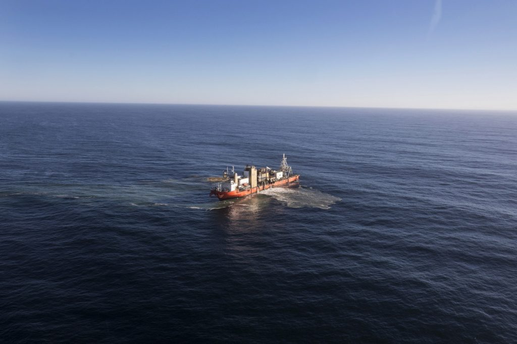 """The Mafuta diamond mining vessel operated by  searches for diamonds using a """"crawler"""" tractor to suck up sediment from the seabed during operations in the Atlantic Ocean off the coast of Namibia in 2017."""