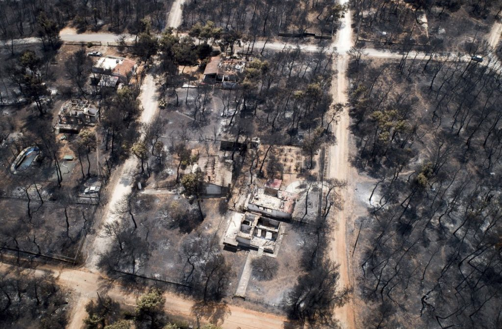 The death toll rose to 82 following Monday's wildfire east of the Greek capital that left behind a scorched landscape.