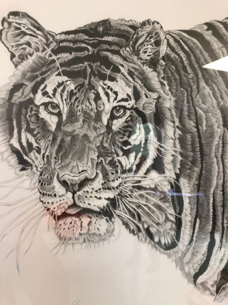 """Neal Caron of Oakland had several works on display, including  a graphite drawing of a tiger. He said his artwork and poetry give him an escape from memories of his time as a Navy medic. """"I lose myself in the art and in the words, and it is therapy for me, and I can see how it can be for others,"""" he says."""