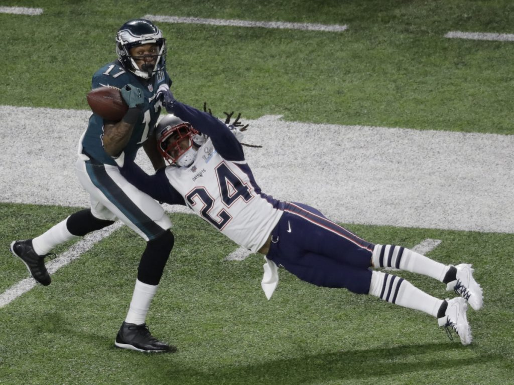 New England Patriots cornerback Stephon Gilmore breaks up a pass intended for Philadelphia Eagles wide receiver Alshon Jeffery during the first half of the NFL Super Bowl 52 football game Sunday, Feb. 4, 2018, in Minneapolis. The pass was later incepted by New England Patriots strong safety Duron Harmon. (AP Photo/Eric Gay)