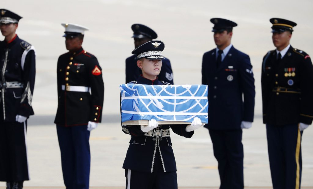 A soldier carries a casket containing the remains of a U.S. soldier who was a casualty of the Korean War during a ceremony Friday at Osan Air Base in Pyeongtaek, South Korea.
