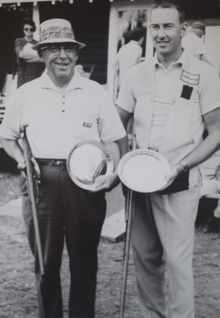 Cal Stinson Jr., right, and Cal Stinson Sr. pose with their prizes at a trapshooting competition in New Hampshire in 1960. The two competed side by side for years and are the only father-son inductees in the Maine Sports Hall of Fame.
