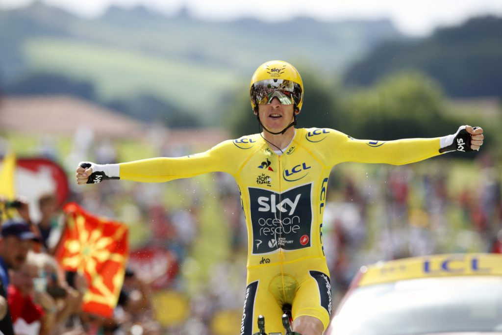 Britain's Geraint Thomas, wearing the overall leader's yellow jersey reacts as he crosses the finish line in Espelette, France on Saturday.