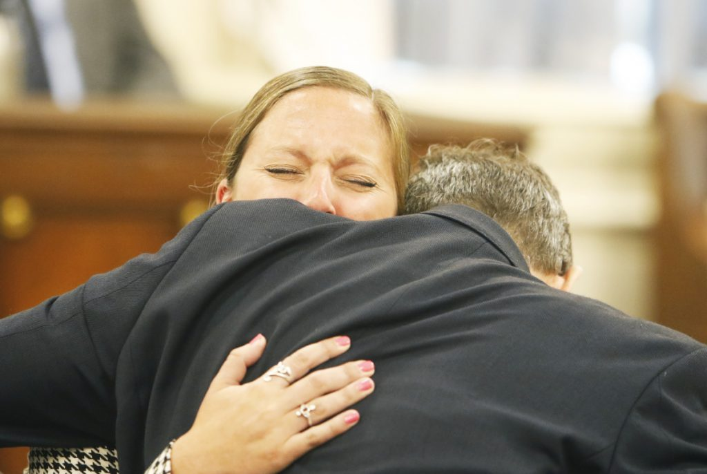 Jill Lamontagne hugs defense attorney Scott Gardner after being found not guilty by a jury at York County Superior Court on July 26.