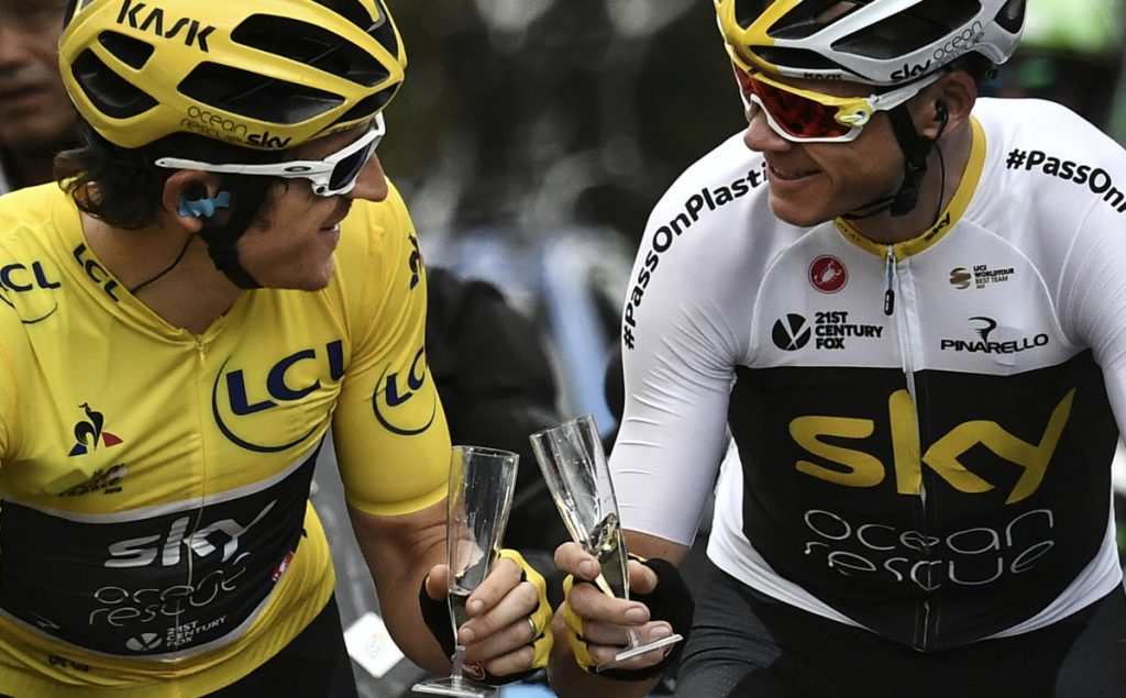 Geraint Thomas, left, wearing the overall leader's yellow jersey and teammate Christopher Froome toast with during the 21st and last stage of the 105th edition of the Tour de France on Sunday between Houilles and Paris Champs-Elysees.