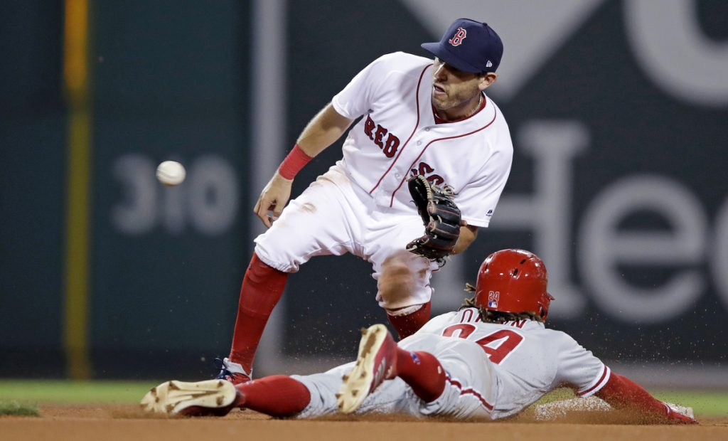Boston's newly acquired second baseman Ian Kinsler, top, fields the throw as Philadelphia's Roman Quinn is caught trying to steal second Tuesday's game at Fenway Park in Boston.