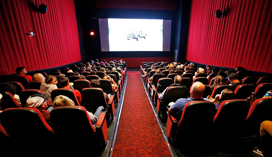 """The audience settles in for the 4:20 p.m. showing of """"Sorry to Bother You"""" at Nickelodeon Cinemas on Saturday. About 80 people claimed free seats out of 124 available. Another 15 seats were reserved for friends and family of the Ferreiras."""