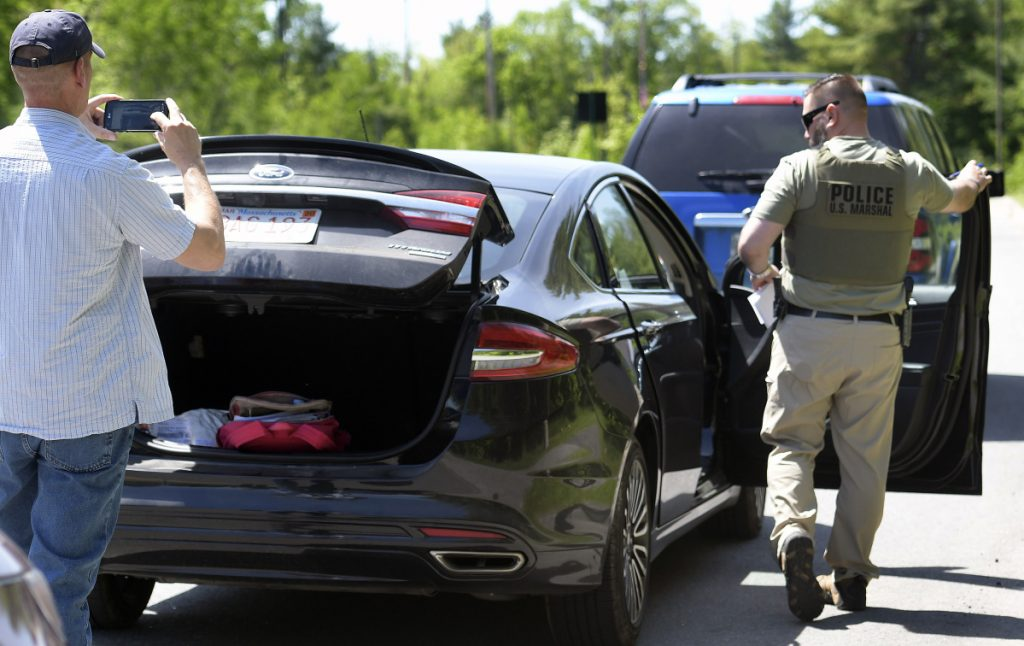 Federal and state investigators process a vehicle on May 30 that agents stopped before arresting the driver, Yashonia Davis, who is wanted in connection with a homicide in New York.