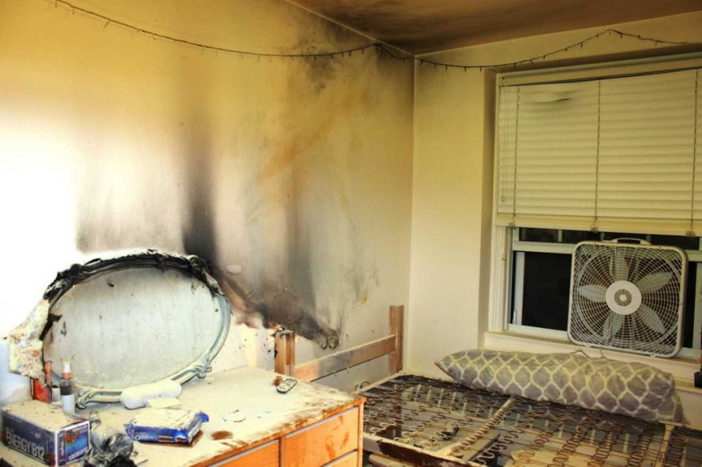 The walls and ceiling of a Colby College dorm room appear black and damaged from the fire and smoke that broke out early Tuesday morning. A student living in the room told investigators that she fell asleep after lighting a candle.