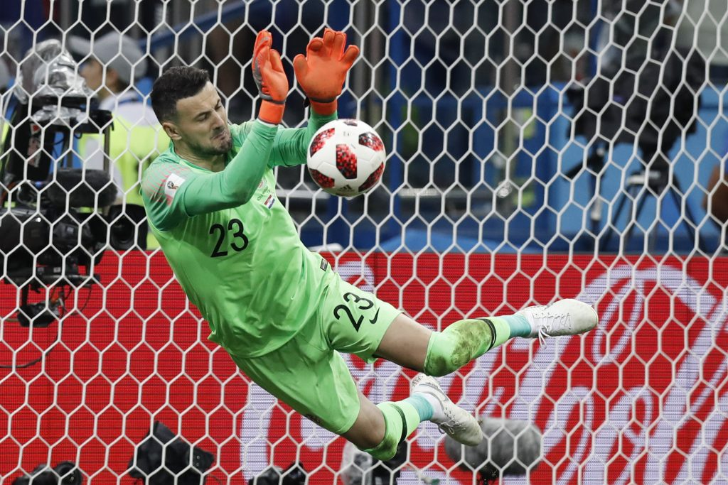 Croatia goalkeeper Danijel Subasic makes a save during a penalty shoot out after extra time during the round of 16 match between Croatia and Denmark on Sunday in Nizhny Novgorod, Russia.