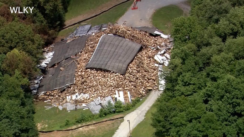 Bourbon whisky lie in a heap Wednesday after the rest of a Barton 1792 Distillery warehouse collapsed in Bardstown, Kentucky – nearly two weeks after part of the decades-old structure came crashing down.